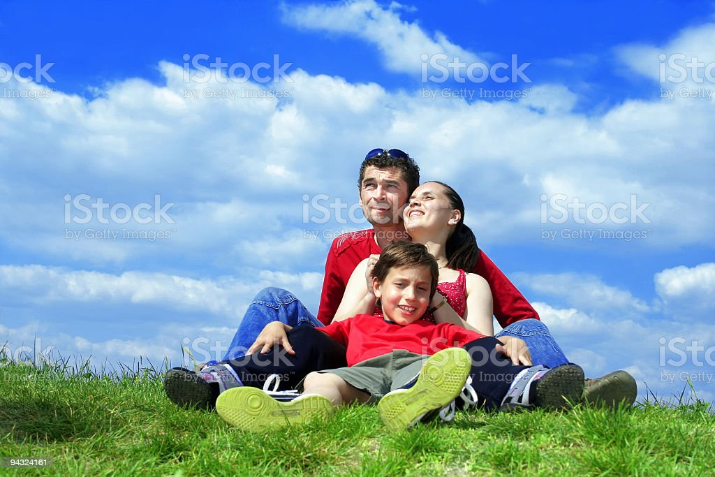 Happy family resting in meadow royalty-free stock photo