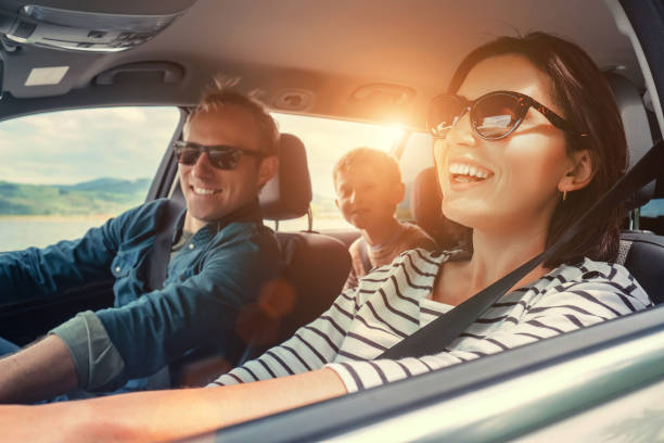 happy family ride in the car - travel family stock photos and pictures