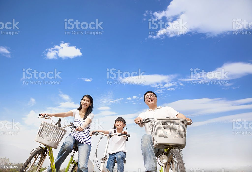 happy family riding bicycle with cloud background stock photo