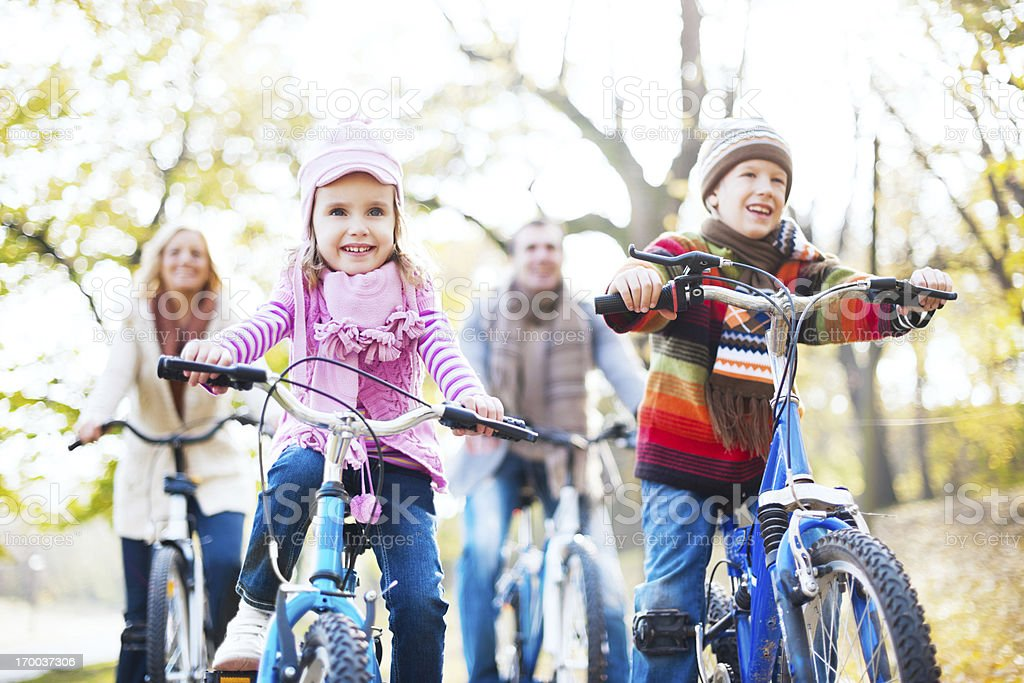 Happy family riding bicycles in nature. royalty-free stock photo