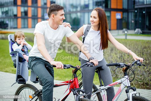 istock Happy family riding bicycles 1020036902