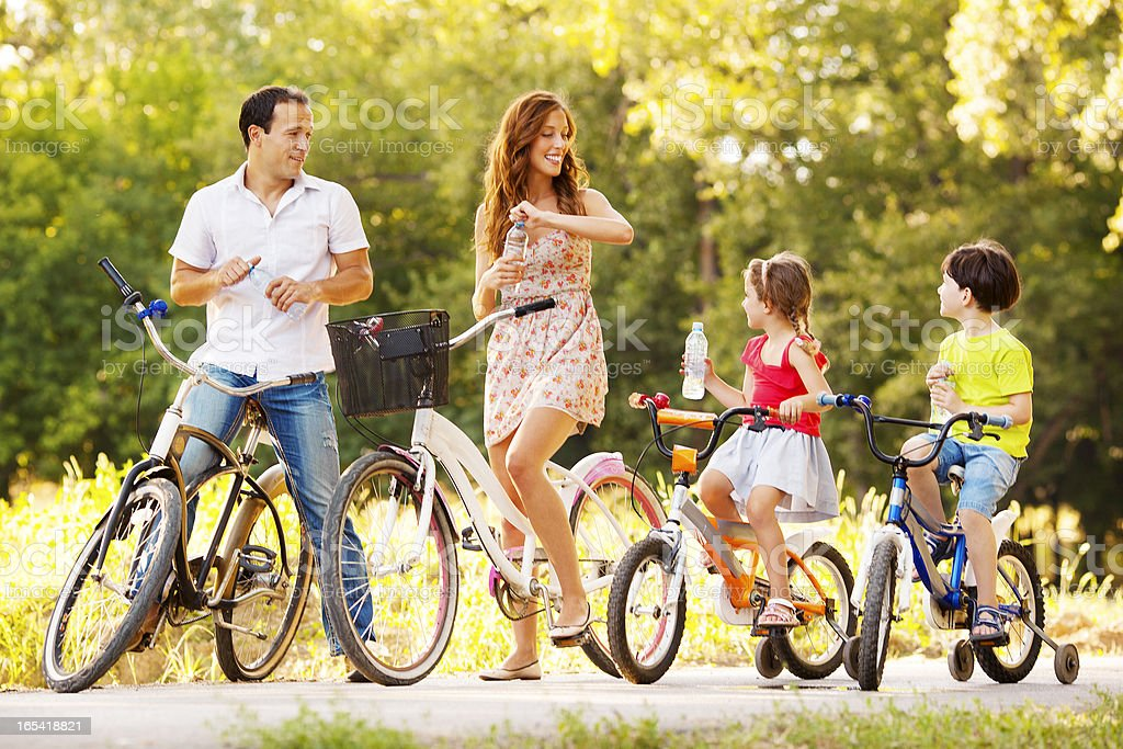 Happy family riding bicycles royalty-free stock photo