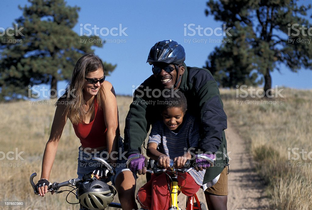 Happy family riding bikes in the country royalty-free stock photo