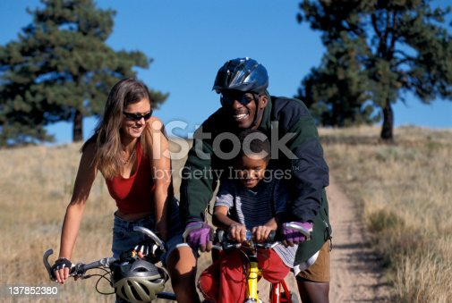 istock Happy family riding bikes in the country 137852380