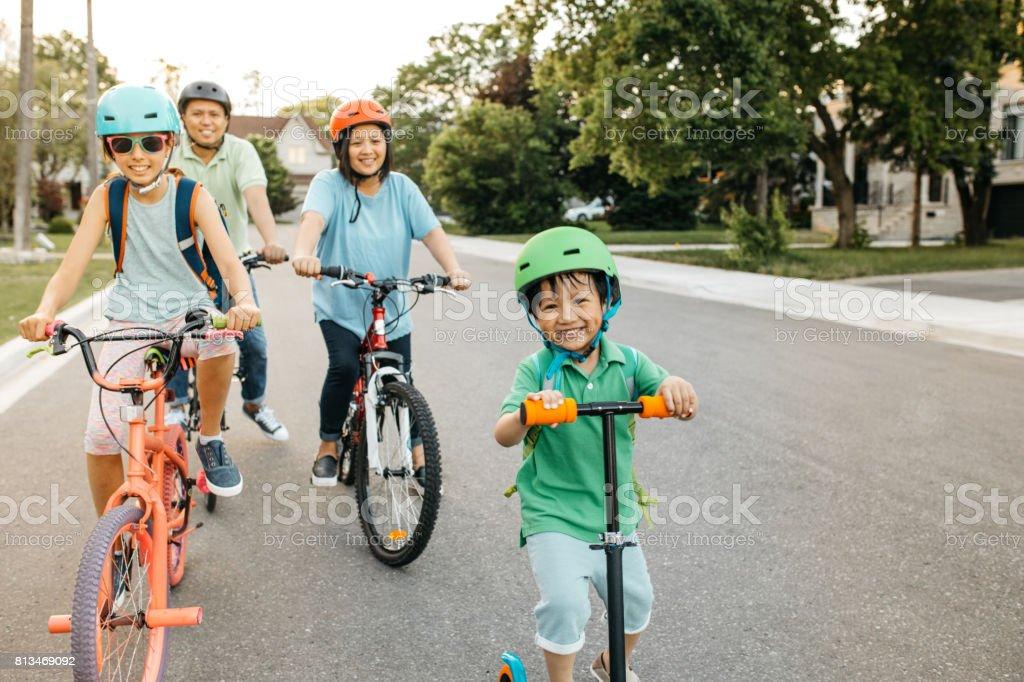 Happy family riding bikes stock photo