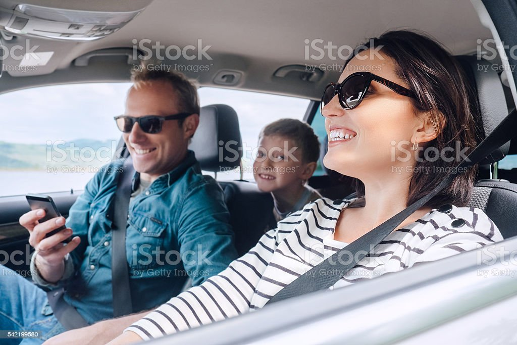 Happy family riding in a car – Foto