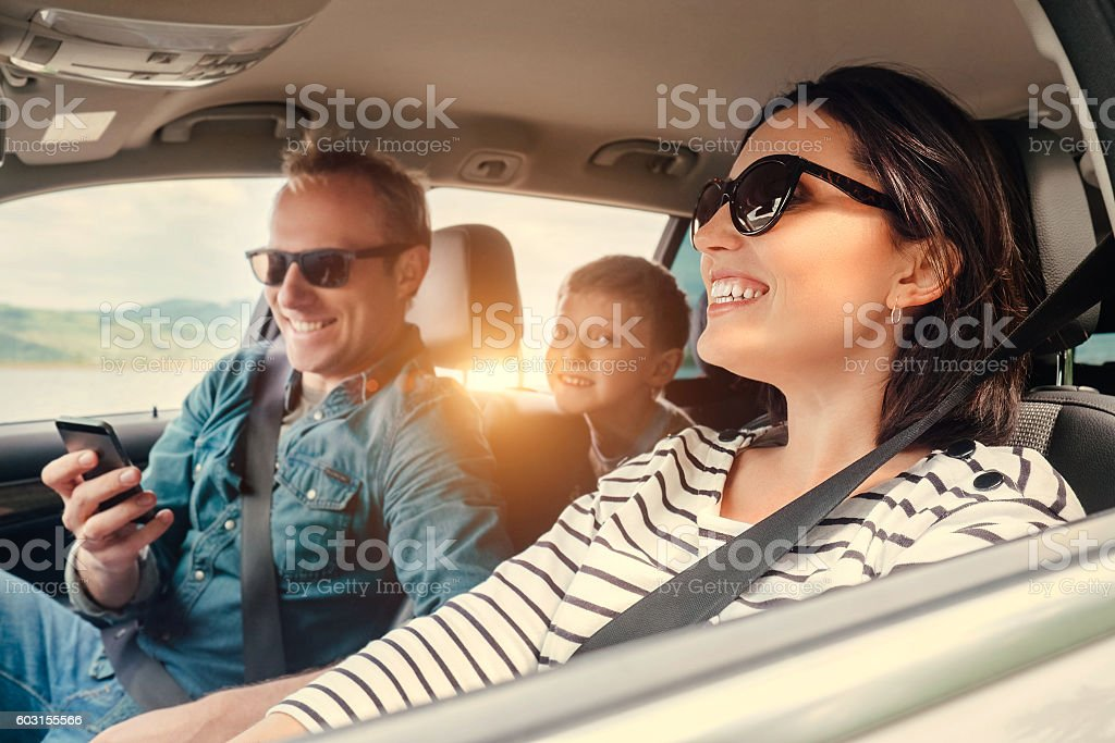 Happy family riding in a car stock photo