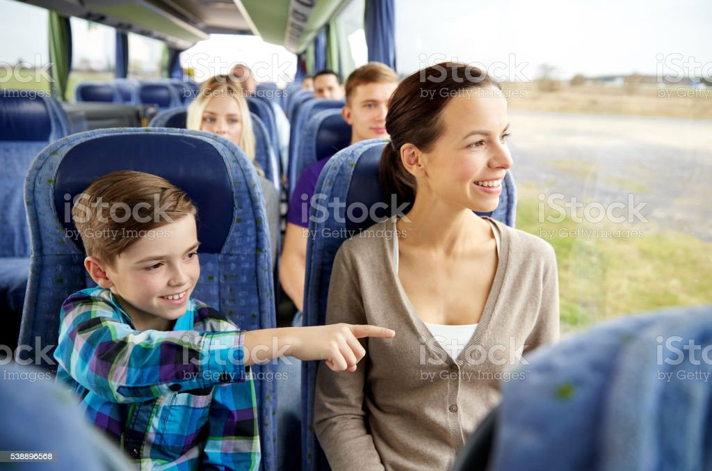 happy family riding in travel bus stock photo