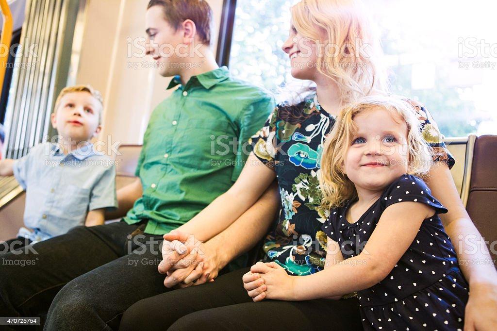 Happy Family Riding Metro Train stock photo