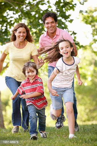 88688880 istock photo Happy family running in the park 155148973