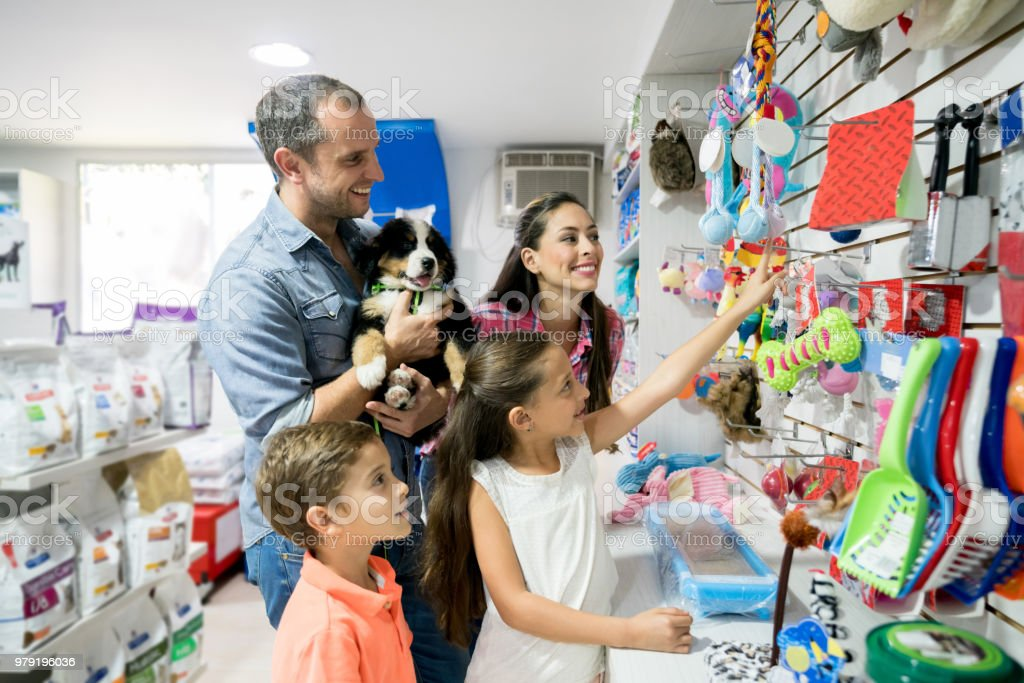 Happy family shopping at a pet shop stock photo