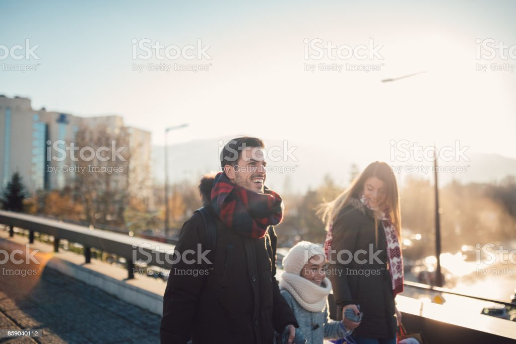 Happy family shopping Christmas gifts stock photo