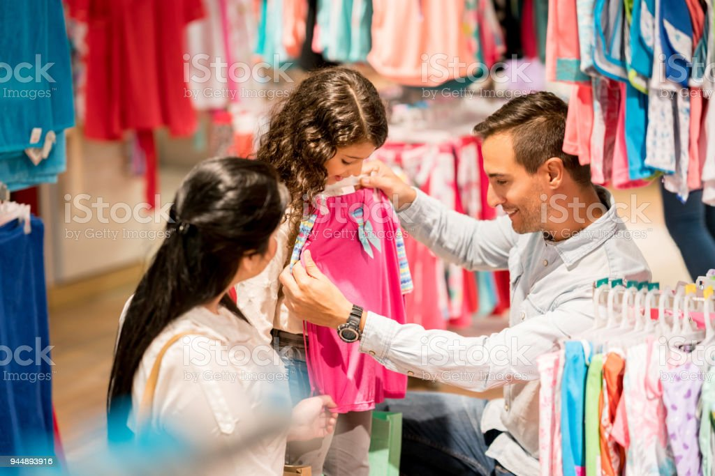 Happy Family Shopping For Clothes At A Store Stock Photo Download Image Now Istock