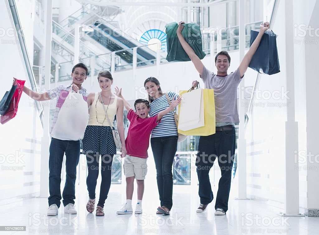 Happy family shopping together in mall royalty-free stock photo