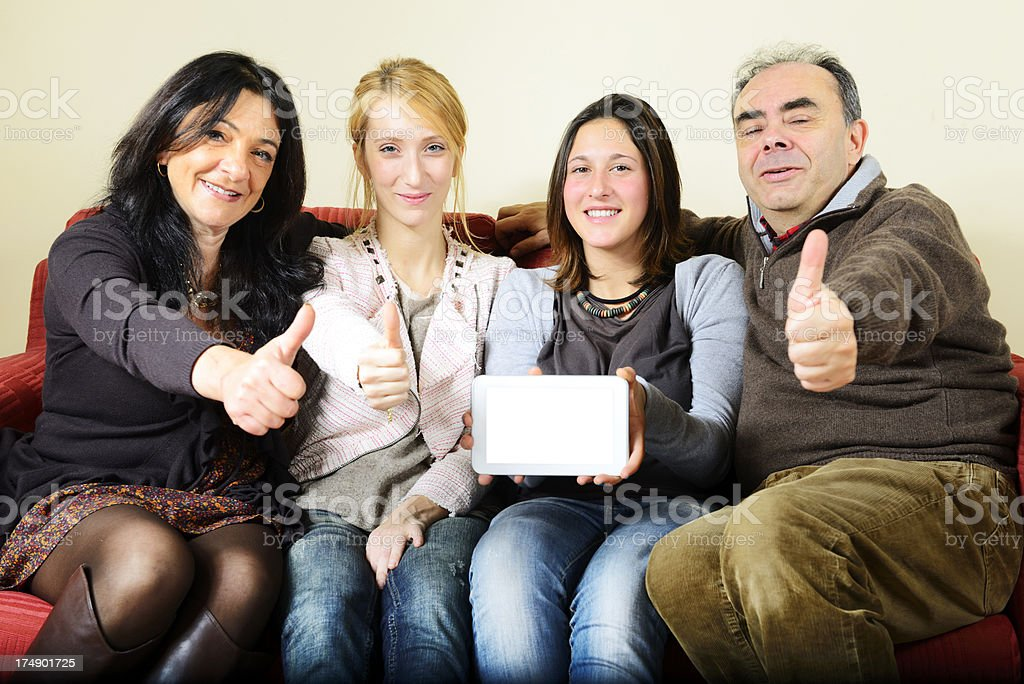 Happy Family Showing Digital Tablet Thumbs Up royalty-free stock photo