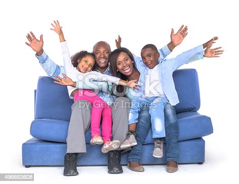 1126155137 istock photo Happy family sitting on a couch 496663608