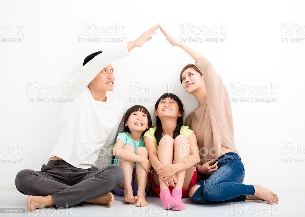 happy family sitting together and making the home sign stock photo