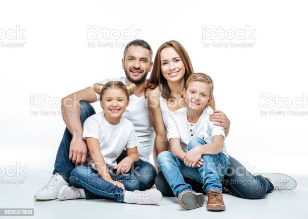 Happy family sitting together
