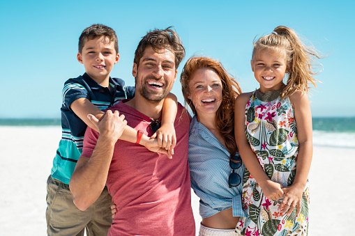 Happy family smiling at beach