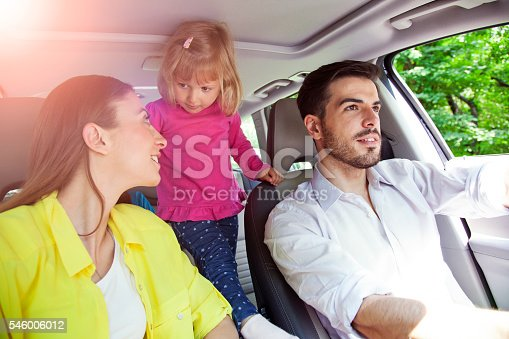 528474010istockphoto Happy family smiling at the camera in car 546006012