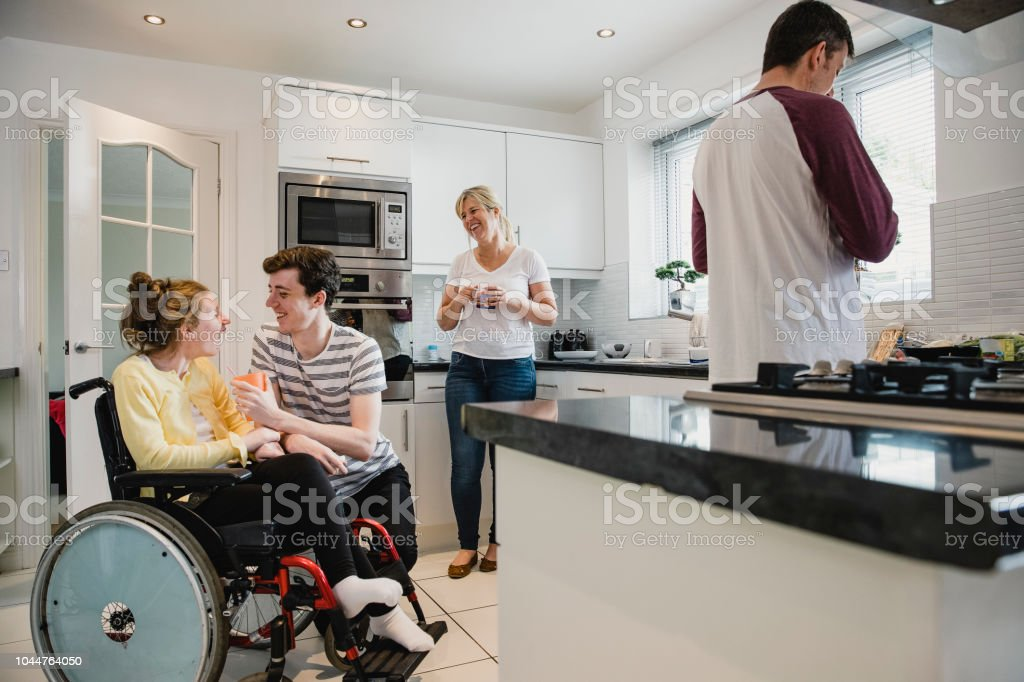 Happy Family Socialising in the Kitchen stock photo
