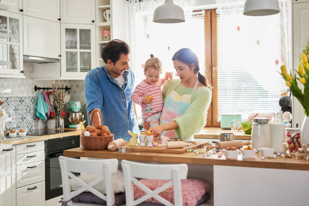 Happy family spending Easter together in the kitchen stock photo