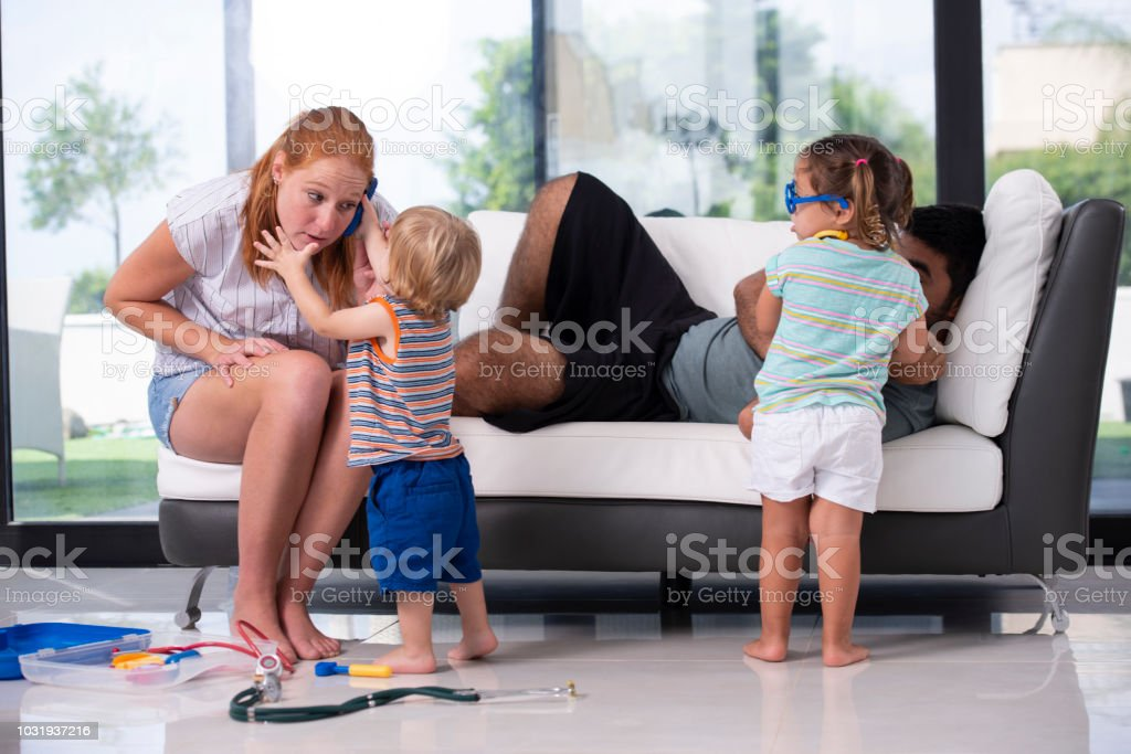 Happy family spending quality time together at living room. stock photo