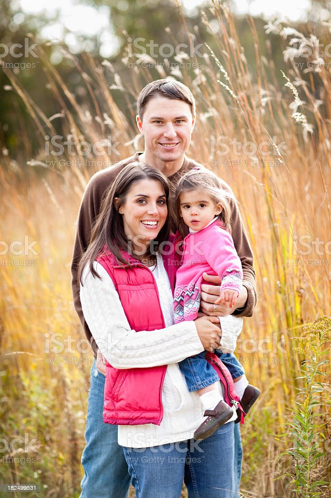 Happy Family Standing in Field During Autumn royalty-free stock photo