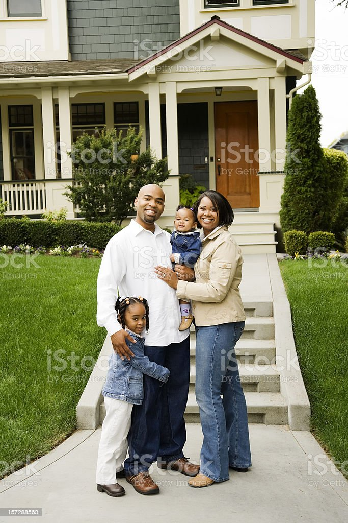 Happy Family Standing In Front Of House Stock Photo & More ...