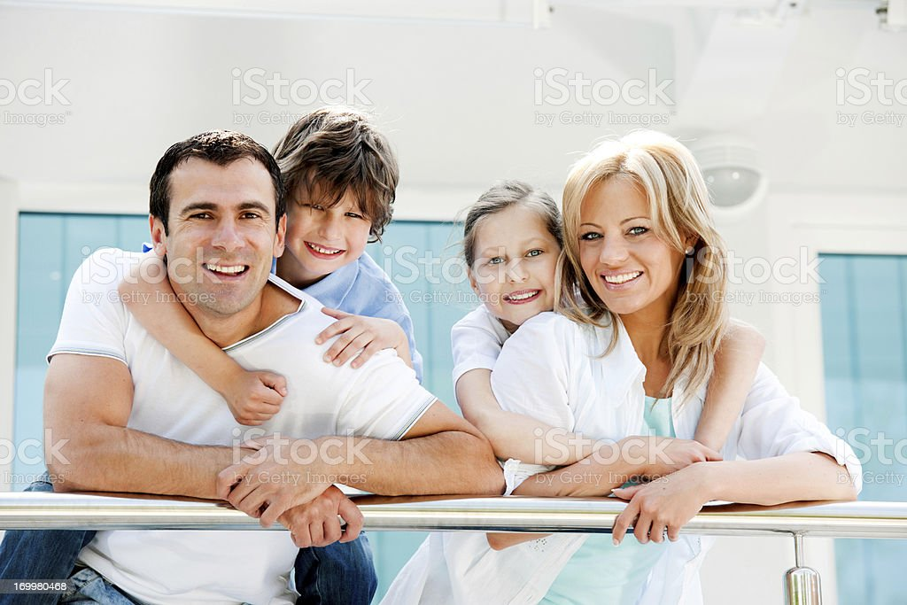 Happy family standing on the balcony. royalty-free stock photo
