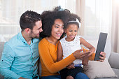 istock Happy family take a selfie with digital tablet 540611322