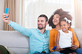 istock Happy family take a selfie with smart phone 540611248