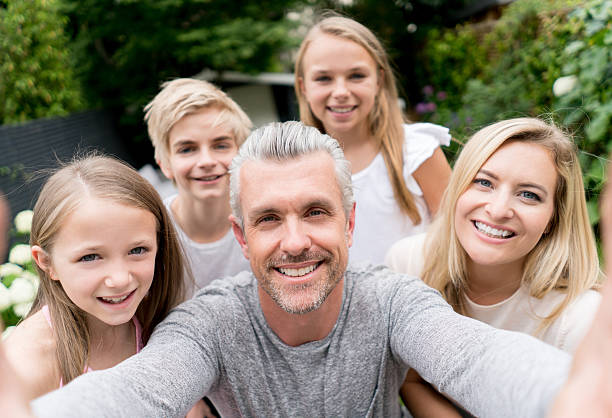 Happy family taking a selfie stock photo