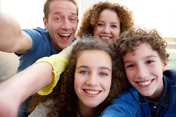 Happy family taking a selfie together stock photo