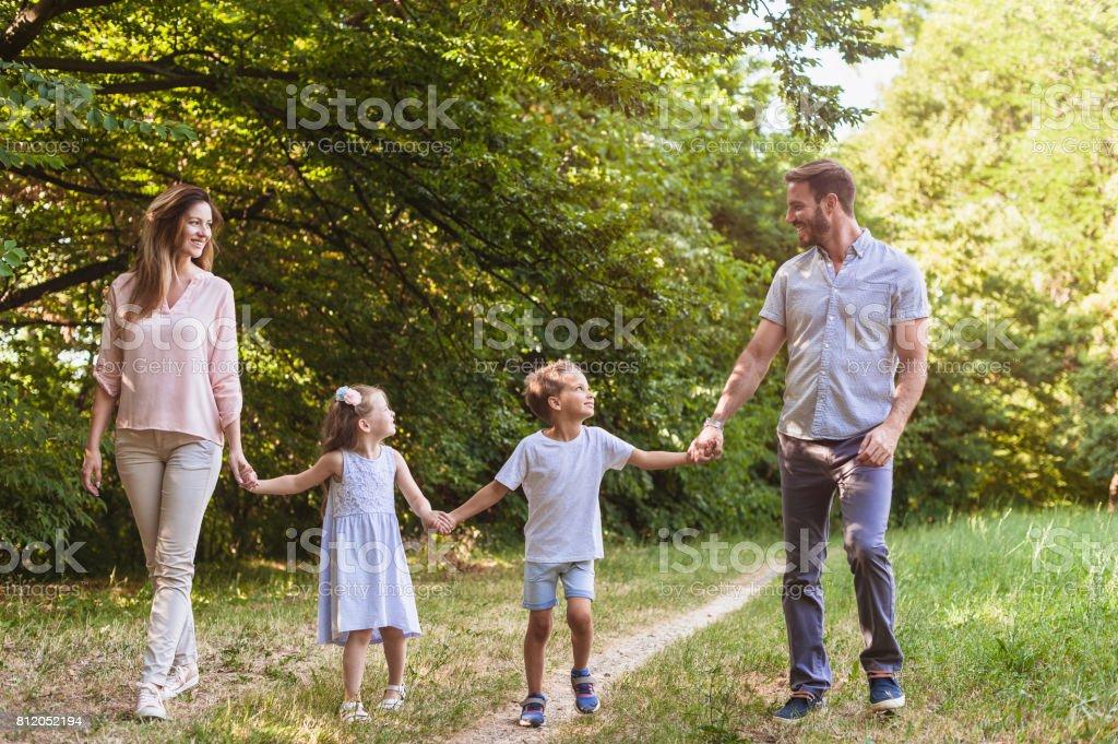 Parents with children enjoying nature summer walk