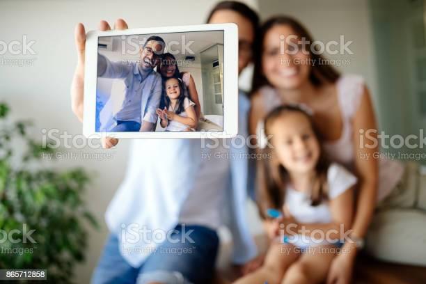 Happy family taking selfie in their house picture id865712858?b=1&k=6&m=865712858&s=612x612&h=quuqth8sziulxbctmpyqscozsontejzt1lu2nuz2io8=