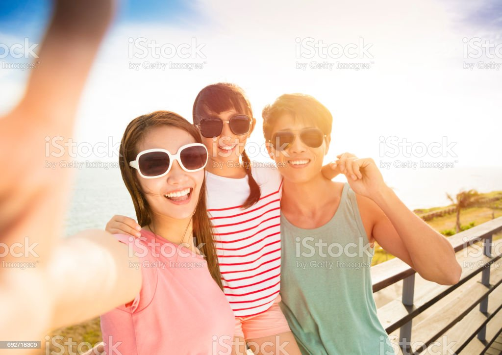 happy family  taking selfie  on summer vacation stock photo