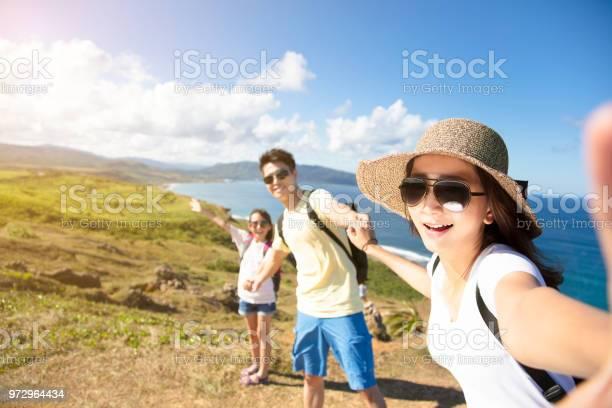 Happy family taking selfie on the coast picture id972964434?b=1&k=6&m=972964434&s=612x612&h=f6f0u7bu7gl98byatyjtj8p5qosm3rs83ioajr9zfum=