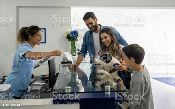 Happy family taking their dog to the vet picture id1162639214?b=1&k=6&m=1162639214&s=612x612&h=ycezk2mrpawbecophcrtuanxfalgbihjysgmolpyfbs=