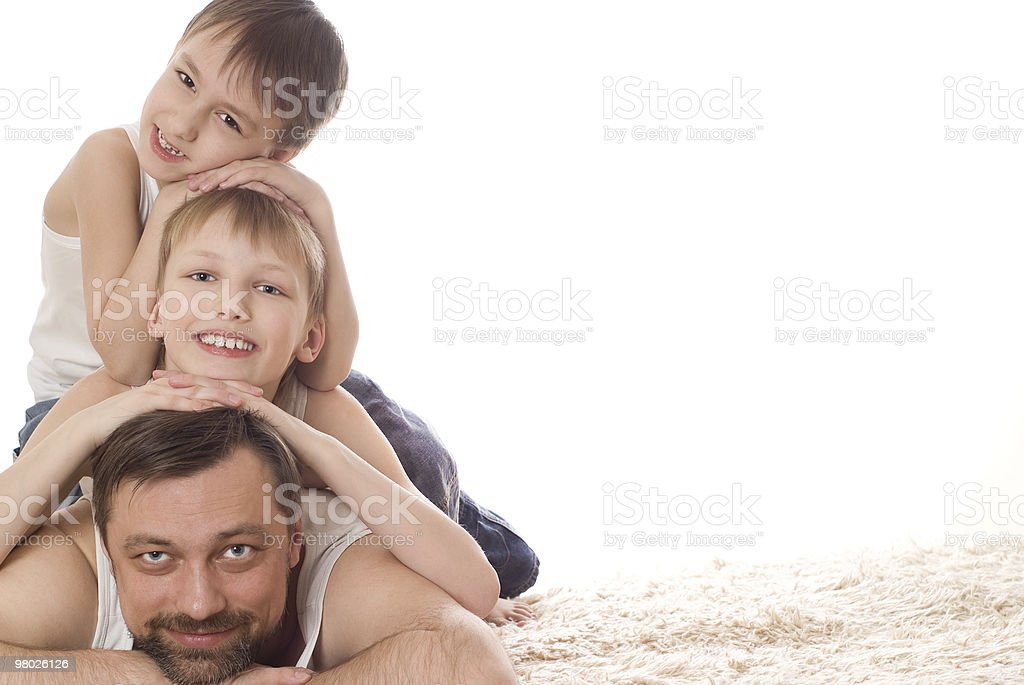 Happy family three lying royalty-free stock photo