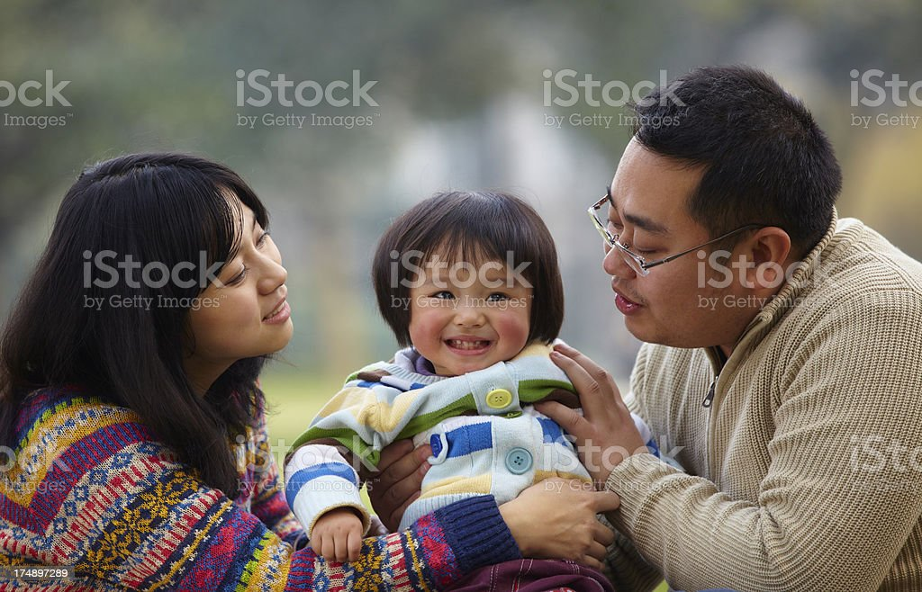 happy family together in the park royalty-free stock photo
