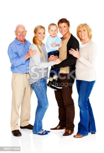 Full length portrait of a happy family standing together isolated on white background