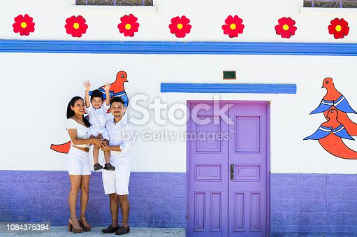 Happy family traveling through the colorful city of Antioquia located east of Lima. Summer holidays and vacation concept