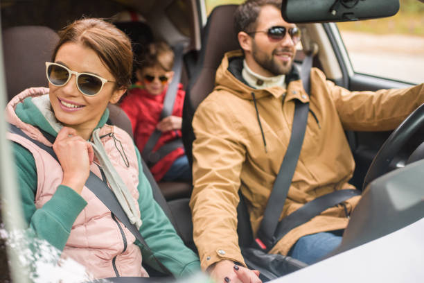 Happy family travelling by car stock photo