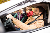 istock Happy family travelling by car 669614126