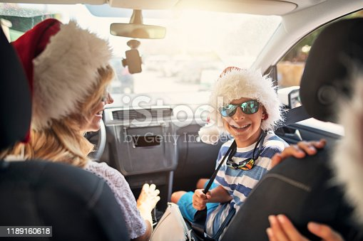 639770050 istock photo Happy family travelling to beach on Summer Christmas 1189160618