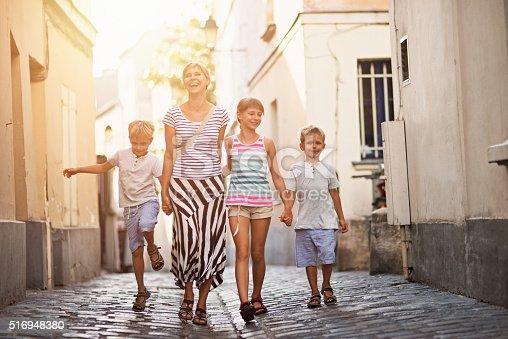istock Happy family visiting Paris Montmartre 516948380