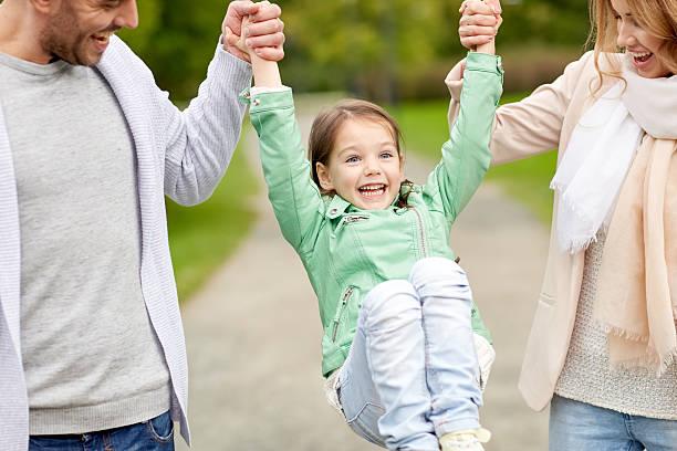 happy family walking in summer park and having fun - mini amusementpark stockfoto's en -beelden