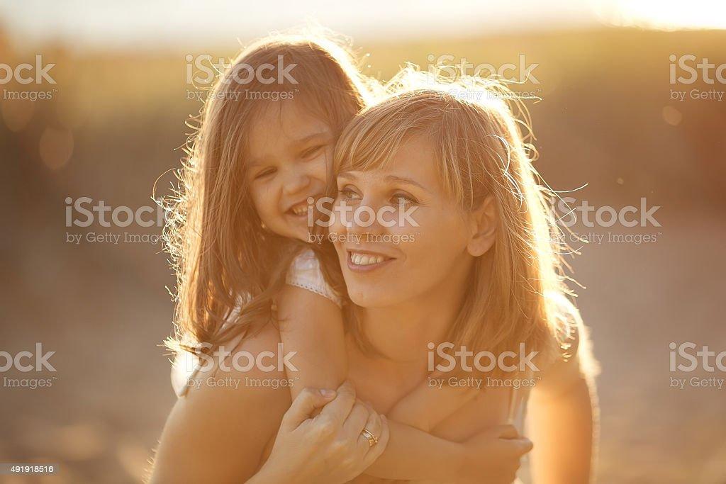 Happy family walking in summer stock photo