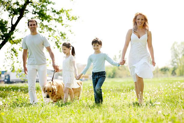 Happy family walking their dog in a park picture id183825677?b=1&k=6&m=183825677&s=612x612&w=0&h=xikobh1daawwoeesquk ujx8dwkvxanmlf7xxoo19fi=